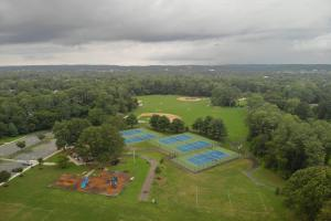 Aerial view of baseball field and tennis courts